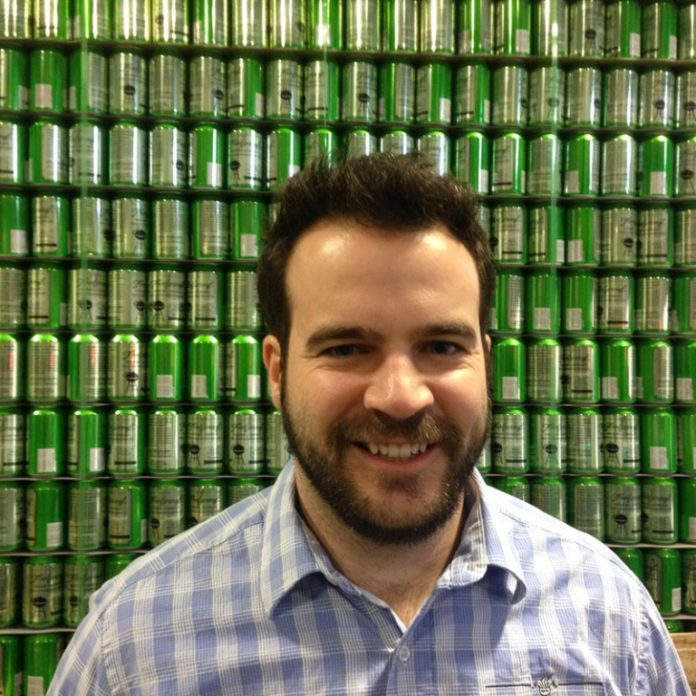 BEER MARKET: Nick Garrison, founder of Pawtucket-based Foolproof Brewing, traded a career at Raytheon for his passion project after visiting a brew pub in Quebec. / COURTESY FOOLPROOF BREWING
