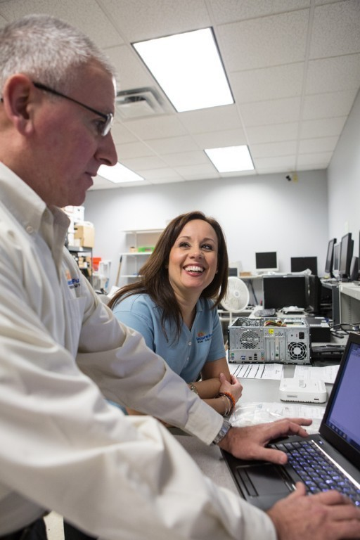 SKILLED LABOR: Lisa Shorr, co-owner of Secure Future Tech Solutions, works with remote support engineer Ben Lyopns. Her husband and company co-owner, Eric Shorr, says finding qualified employees is the firm's No. 1 hurdle. / PBN PHOTO/RUPERT WHITELEY