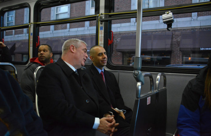 RIDING A RHODE ISLAND PUBLIC TRANSIT AUTHORITY BUS are Warwick Mayor Scott Avedisian, left, and Providence Mayor Jorge O. Elorza. They took the bus from Elorza's neighborhood in the city's Silver Lake section to Kennedy Plaza, for a ribbon-cutting ceremony to celebrate the transit hub's reopening. / COURTESY RIPTA