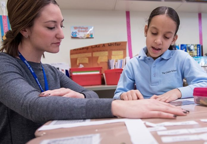 INCLUDING STUDENTS: Kim Scuito, a fourth-grade teacher at the Grace School, works with student Yolanny Estevez. The division of Meeting Street works toward an inclusive approach for students with disabilities. / PBN PHOTO/MICHAEL SALERNO