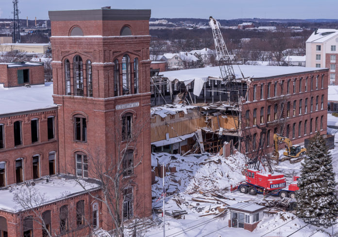 AFTER FINDING IT NOT FEASIBLE to redevelop the Elizabeth Mill in Warwick near T.F. Green Airport, Michael Integlia & Company began demolition of the 19th-century structure to make room for a 300,000-square-foot mixed-use building. / PBN PHOTO/ MICHAEL SALERNO