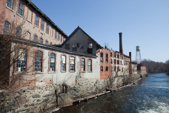DEVELOPER Larry Silverstein's plan to redevelop Pontiac Mills in Warwick includes creating a riverwalk along the Pawtuxet River the runs alongside the old textile mill. / PBN FILE PHOTO/RUPERT WHITELEY