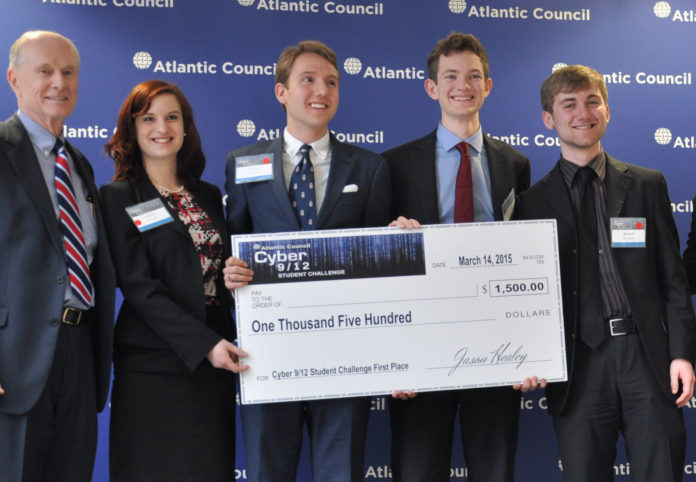A BROWN UNIVERSITY UNDERGRADUATE cybersecurity team - Celina Stewart, second from left, Luke Camery, Sam Brebner, and Jared Schober, standing with coach John Savage - had the best plan and made the best urgent decisions to deal with a fictitious cyber attack scenario in the Philippines, winning a Cyber 9/12 Student Challenge last weekend in Washington, D.C. / COURTESY THE ATLANTIC COUNCIL