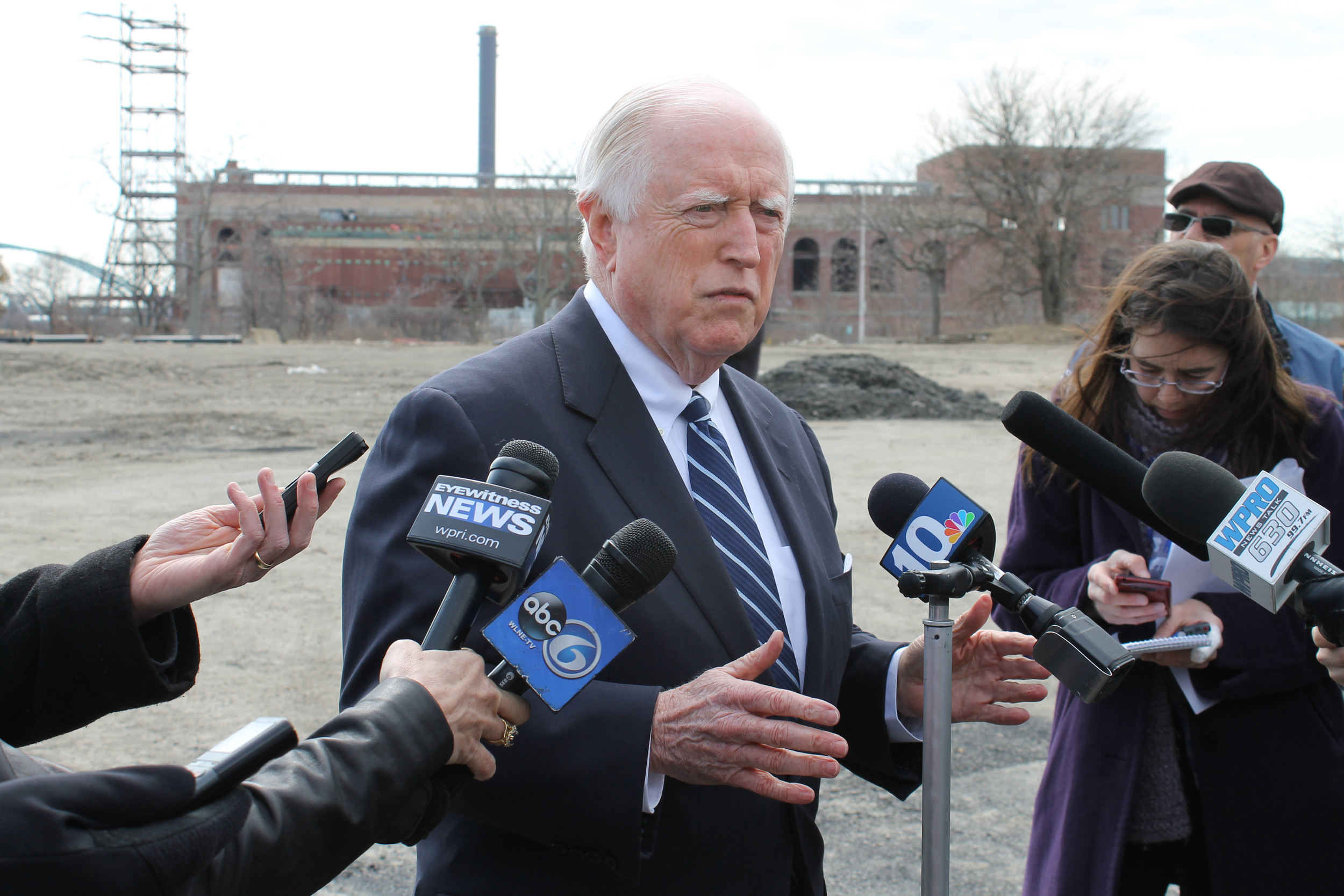 ATTORNEY JAMES J. Skeffington, the new team president of the Pawtucket Red Sox, describes the site plan for the proposed AAA ballpark in Providence. In the background is the former power plant that will be renovated as part of the South Street Landing project. / PBN PHOTO/MARY MACDONALD