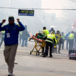 FIRST RESPONDERS rush to where two explosions occurred along the final stretch of the Boston Marathon on Boylston Street in Boston on April 15, 2013. A jury in Boston federal court convicted Dzhokhar Tsarnaev on Wednesday of carrying out the biggest terror attack on U.S. soil since 2001; now jurors in the Boston Marathon bombing case will decide if he should die or spend life in prison. / BLOOMBERG/KELVIN MA