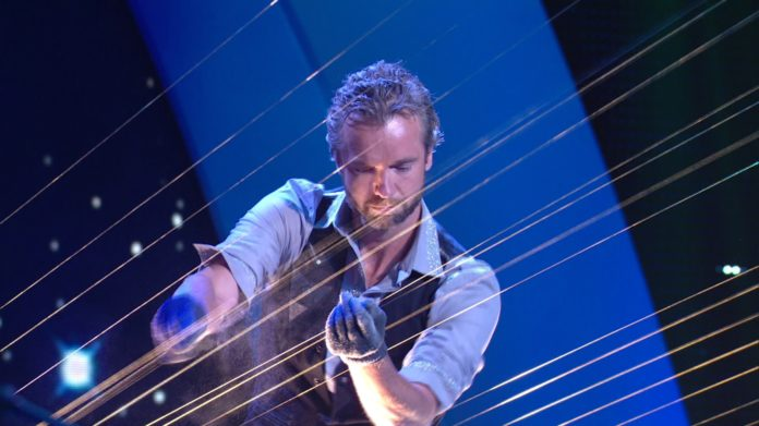 EARTH HARP founder William Close is shown playing the instrument - billed as the world's largest stringed instrument. Close will play the Earth Harp at the International Arts Festival this week in downtown Providence.