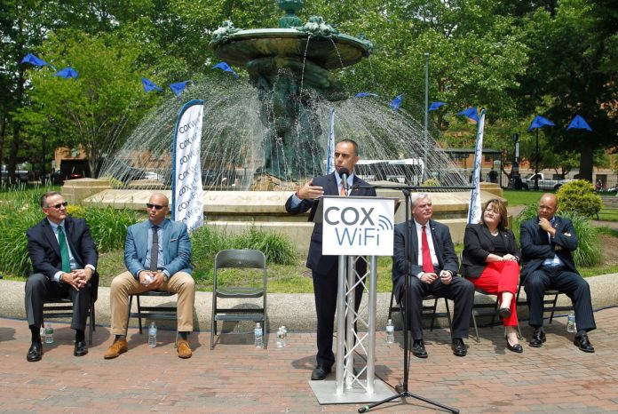 COX COMMUNICATIONS said that Kennedy Plaza in Providence has been wired with free high-speed Wi-Fi for Cox Communications customers. Providence Mayor Jorge O. Elorza is seen speaking at the event celebrating the launch on Thursday. Joining him, from left to right, are Jay Allbaugh, senior vice president and region manager, Cox Communications; Cliff Wood, executive director, Downtown Providence Parks Conservancy; Scott Avedisian, Warwick mayor and Rhode Island Public Transit Authority chairman; Jo-Ann Ryan, councilwoman, Providence; and state Sen. Juan PichardoThursday, June 11, 2015. (Stew Milne for Cox Communications) / COURTESY STEW MILNE/COX COMMUNICATIONS