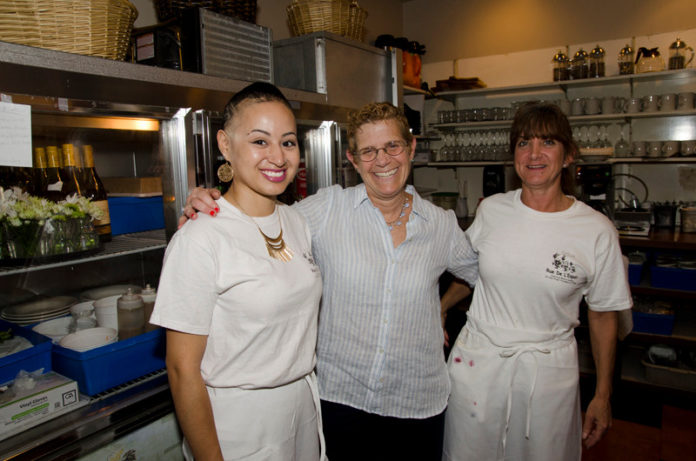 TIPPING POINT: Deb Norman, center, owner of Rue De L'Espoir, with employees Casandra Robinson, left, and Alycyn Bouckaert. Norman thinks the the tipped minimum wage should be raised by a dollar a year for at least three years. / PBN PHOTO/ JAIME LOWE