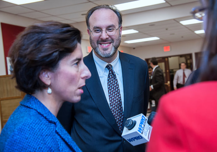 STEFAN PRYOR, center, the state commerce secretary, will be the morning speaker at the eighth annual Supply Chain Management (SCM) Summit on Thursday at Bryant University. Gov. Gina M. Raimondo is shown on the left. / PBN FILE PHOTO/MICHAEL SALERNO