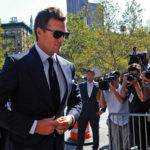 TOM BRADY, quarterback for the New England Patriots, center, arrives at federal court in New York on Aug. 12. A U.S. District Court judge on Thursday overturned Brady's four-game suspension for using underinflated footballs in a January playoff game.