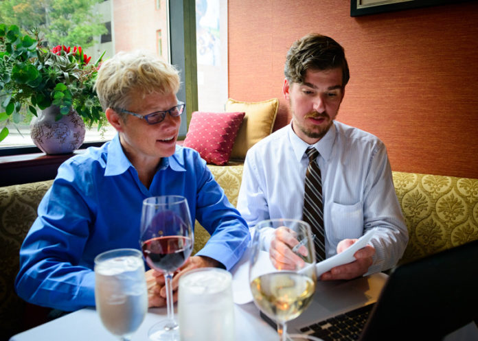 ON THE MENU: Stephen Willson, right, front-of-the-house manager for Gracie's restaurant in Providence, reviews scheduling for a new corporate-outings program with consultant Val Littlefield. / COURTESY  JWESSEL  PHOTOGRAPHY FOR GRACIE'S PROVIDENCE