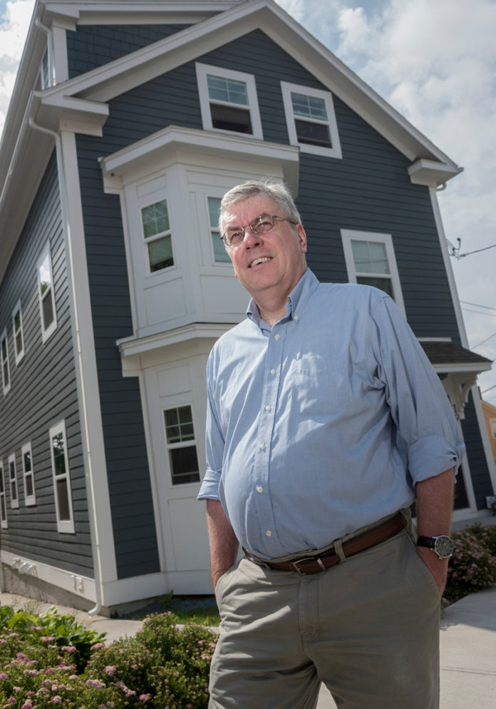 FRANK SHEA is leaving his position as executive director of ONE Neighborhood Builders to become CEO of Urban Edge, a neighborhood redevelopment corporation that serves several neighborhoods in Boston. He is shown in front of a home at 23 Bowdoin St. in Providence that was formerly in foreclosure. / PBN FILE PHOTO/ MICHAEL SALERNO