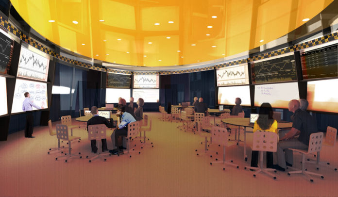 PLUGGED IN: Providence College's planned School of Business will feature a trading room, as depicted in the above rendering, that will include a Bloomberg terminal for real-time connections to the stock market. / COURTESY SYMMES MAINI  & MCKEE  ASSOCIATES