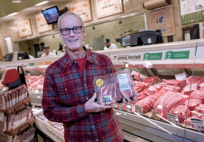 WASTE NOT: Michael Brown, CEO and president of Packaging 2.0, holds the meat-packaging tray that his company produces from 100 percent recycled materials and which itself can be recycled. / PBN PHOTO/MICHAEL SALERNO
