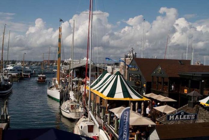 SURF AND TURF: This is an image from the 2014 Bowen's Wharf Seafood Festival in Newport, showing the tent that sheltered three restaurants serving shellfish, chowder and other seafood dishes. A portion of Newport Harbor and a cruise ship are also visible. / COURTESY TRIXIE B. WADSON/BOWEN'S WHARF CO.