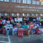 THEY DELIVER: Panera Bread employees help with the distribution portion of the December 2014 Children's Friend annual holiday drive. / COURTESY CHILDREN'S FRIEND