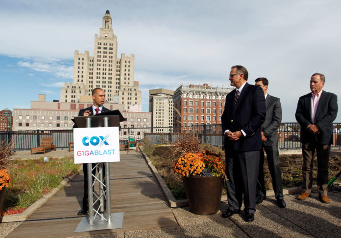 PROVIDENCE MAYOR JORGE O. Elorza is shown at the podium during Cox Communications' announcement about the launch of gigabit Internet service in Providence.  Also shown, from left to right, Jay Allbaugh, senior vice president and region manager, Cox Communications; Dan Nichols, project manager for the Foundry building; and Buff Chace, managing partner, Cornish Associates. / COURTESY COX COMMUNICATIONS
