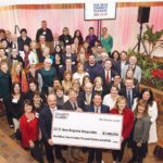 BIG IDEA, BROAD SUPPORT: The yearly CVS Health Charity Classic golf tournament benefits nearly 80 local nonprofits. Last year's event ended up contributing $1.4 million to the organizations, adding to the total of more than $18 million since its inception in 1999. Holding the check are, from left, CVS President and CEO Larry J. Merlo, professional golfer and event co-host Brad Faxon, pro golfer and co-host Billly Andrade, CVS Senior Vice President of Corporate Social Responsibility and Philanthropy Eileen Howard Boone, plus CVS Senior Director of Community Relations Faith Weiner at far right. / COURTESY CVS HEALTH