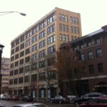 The Palmer Block, or Cosmopolitan building, at 100 Fountain St. in Providence, center, is one of four historic redevelopment projects that had received property tax incentives from the city more than a decade ago. / PBN PHOTO/MARY MACDONALD