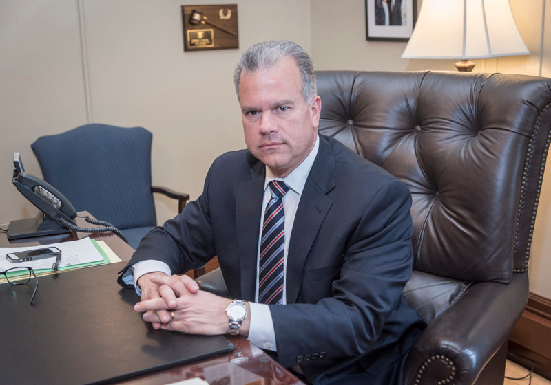 HOPEFUL OUTLOOK: House Speaker Nicholas A. Mattiello, D-Cranston, is seen in his office at the Statehouse. Mattiello says Rhode Island's economic health is improving. / PBN PHOTO/MICHAEL SALERNO