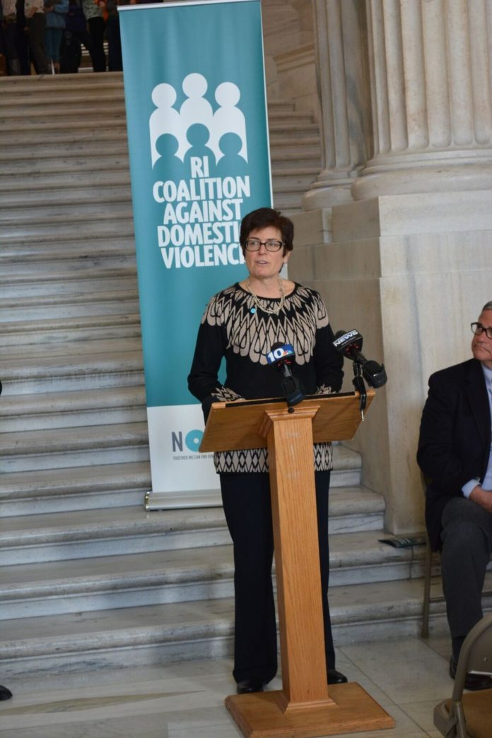 Deborah DeBare, executive director of the Rhode Island Coalition Against Domestic Violence, speaks at the organization's press conference at the Statehouse late last month. / COURTESY KRISTA D'AMICO