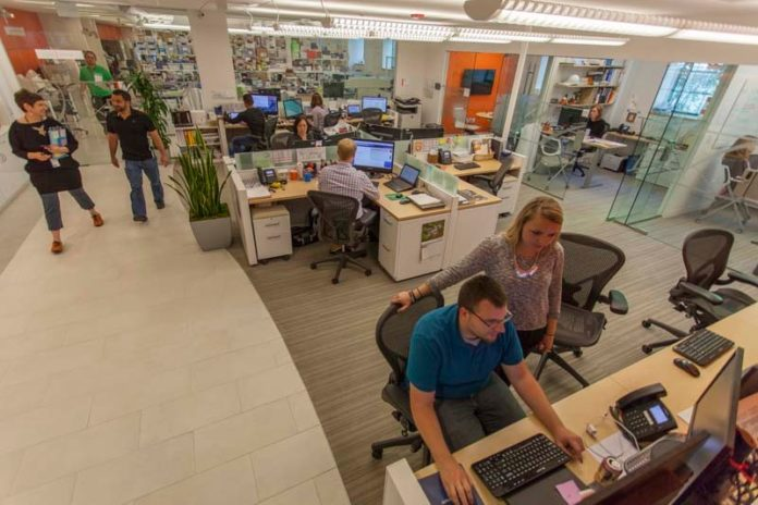 INFORMATION EXCHANGE: Clients are seen at LabCentral. Young companies pay a reasonable, all-inclusive monthly fee to share common facilities and equipment – and often, ideas. / COURTESY LABCENTRAL, PAUL AVIS/AVIS STUDIO