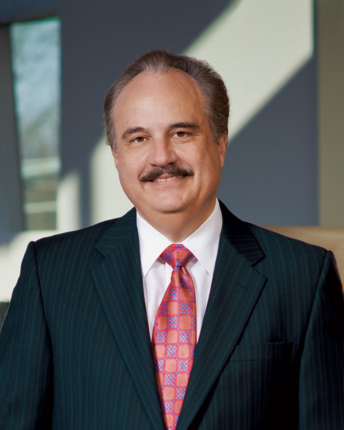 CVS HEALTH Corp. President and CEO Larry Merlo  saw his compensation fall last year to $28.9 million. It was $32.3 million in 2014. / COURTESY CVS