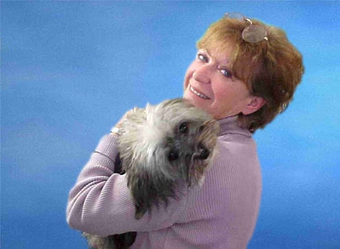 """Elise Penn Pansey, a Realtor with Century 21 Butterman & Kryston in Pawtucket, is a consistent top-seller who also markets herself as the """"pet-friendly Realtor."""" She is holding her dog Brooshi. / COURTESY ELISE PENN PANSEY"""