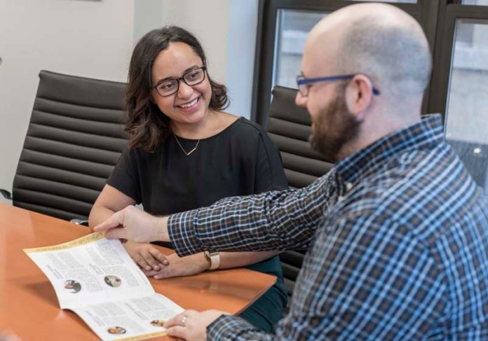 EDUCATION ADVOCATES: Elsa Duré, CEO of Rhode Island Mayoral Academies, meets with Ryan Kowal, operations and finance associate, in their Providence office. / PBN PHOTO/ MICHAEL SALERNO