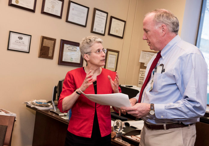 CREATING A NEW TOOL KIT: Dr. Angela M. Caliendo, University Medicine Foundation vice president, with foundation President Dr. Louis B. Rice, spearheaded the group's creation of a leadership academy for its physicians. / PBN PHOTO/MICHAEL SALERNO
