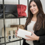 ACCESSIBILITY: Nicole D'Andrea, design director and CEO of D'Andrea Handbags, displays some of her creations. D'Andrea tested the accessories with members of University of Rhode Island sororities. / PBN FILE PHOTO/MICHAEL SALERNO
