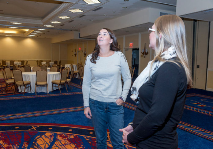 CURRENT EVENTS: Stephanie Frazier-Grimm, left, owner and founder of Couture Parties and The Confetti Foundation, meets with Mary Lynn Williams, event manager at the Newport Marriott. / PBN FILE PHOTO/MICHAEL SALERNO