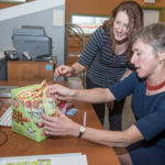 THE RIGHT FIT: Deborah Schimberg, right, owner and head of Verve Inc., which makes Glee Gum and other confections, discusses product packaging with Molly Lederer, director of communications and marketing. / PBN FILE PHOTO/MICHAEL SALERNO