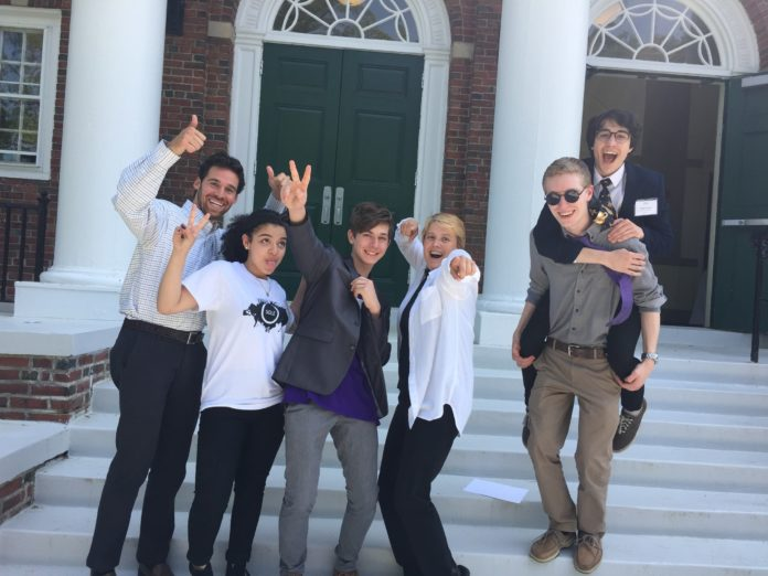 BRANDON LANE, left, program manager of the Met Entrepreneurship Center, is shown with, from left, Met students Gabriella Martinez and Ethan Chandler, and Jodie Woodruff, director of the Met Entrepreneurship Center and Met students Kevin Henkel and Owen Cuseo. The students participated in the annual Network for Teaching Entrepreneurship Business Plan Challenge Regional Competition at Babson College. Chandler captured first place and was named the Ernst & Young Youth Entrepreneur of the Year for New England. / COURTESY THE MET SCHOOL