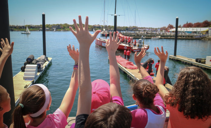 WHAT'S NEXT? Spectators in the Volvo Ocean Race Village watch one of the race boats leave the dock during its 2015 stop in Newport. In 2018, the round-the-globe race will come back to the City By The Sea for its only North American stop. / COURTESY VOLVO OCEAN RACE/CARMEN HIDALGO