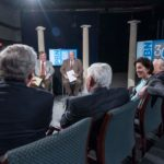 LET'S COMMUNICATE! WJAR-TV Anchor Frank Coletta and PBN Editor Mark S. Murphy, center left and right, spoke with Rhode Island governors about issues they have faced and continue to face and what is best to move the state forward. Foreground, from left, Govs. Donald L. Carcieri, Lincoln C. Almond, Gina M. Raimondo, Edward D. DiPrete. / PBN PHOTOS/ MICHAEL  SALERNO