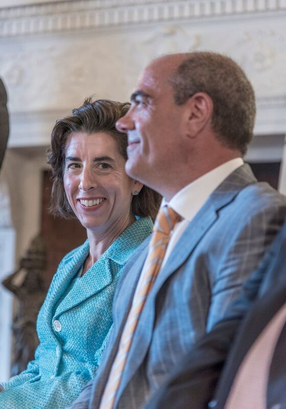 GOV. GINA M. Raimondo and Jeffrey S. Bornstein, GE chief financial officer, are shown at a press conference earlier this month about General Electric Co.'s plans to open a new technology center in Providence; it plans to employ 100 individuals to start. / PBN FILE PHOTO/ MICHAEL SALERNO