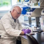 SCIENCE OF SUCCESS: Engineer Carl Carlson is seen in the Quality Control Sample Management Lab at Amgen in West Greenwich. / PBN PHOTO/MICHAEL SALERNO