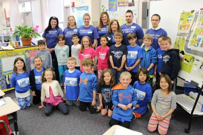IT'S ABOUT COMMUNITY: Eighty-five percent of Washington Trust employees are involved in community projects, such as this teaching day at Stony Lane School in North Kingstown. / COURTESY WASHINGTON TRUST