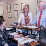 BUSINESS AND PLEASURE: From left, Brenda L. Vucci, legal administrative assistant, Heidi K. Seddon, legal administrative assistant, and Peter V. Lacouture, partner, share a laugh at Robinson & Cole at One Financial Plaza in Providence. / PBN PHOTO/MICHAEL SALERNO