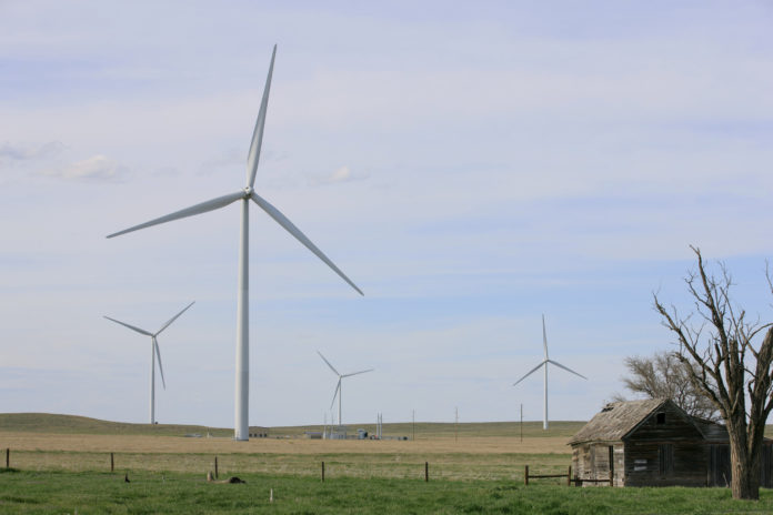 BIG INSTITUTIONS - such as the U.S. armed forces - are signing deals for renewable energy, much of it the result of growing wind energy farms in the Great Plains, including the Colorado Highlands Wind Farm in Fleming, Colo. / BLOOMBERG NEWS PHOTO/MATTHEW STAVER