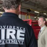 PAUL A. Doughty, right, president of Local 799 International Association of Firefighters in Providence, speaks with a firefighter at the Providence Public Safety Complex. / PBN FILE PHOTO/MICHAEL SALERNO