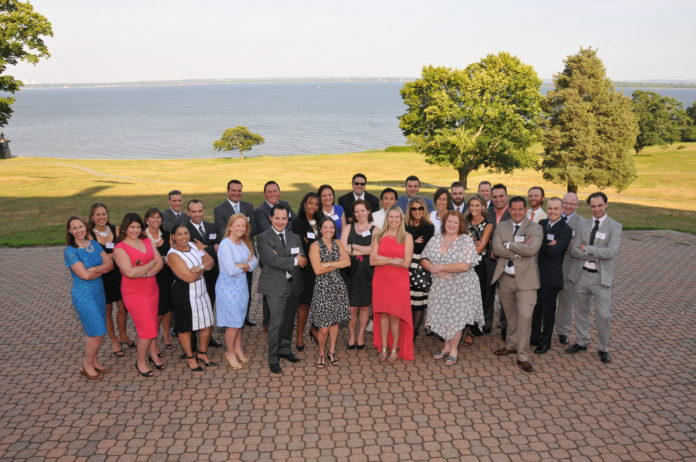 THE PBN 40 UNDER FORTY Class of 2016 shows a little attitude in a group photo at the event celebrating their recognition on Thursday at the Aldrich Mansion in Warwick hard on Narragansett Bay. / PBN PHOTO/MIKE SKORSKI