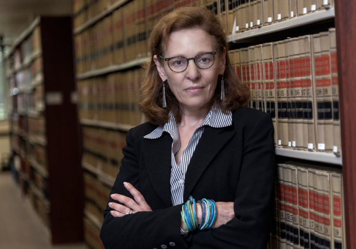 BIT BY BIT: Niki Kuckes, a Roger Williams University School of Law professor, says the 38 Studios Settlement Act allows the state to break up the case and process settlements in piecemeal fashion, rather than having to settle it all at once. / PBN PHOTO/MICHAEL SALERNO