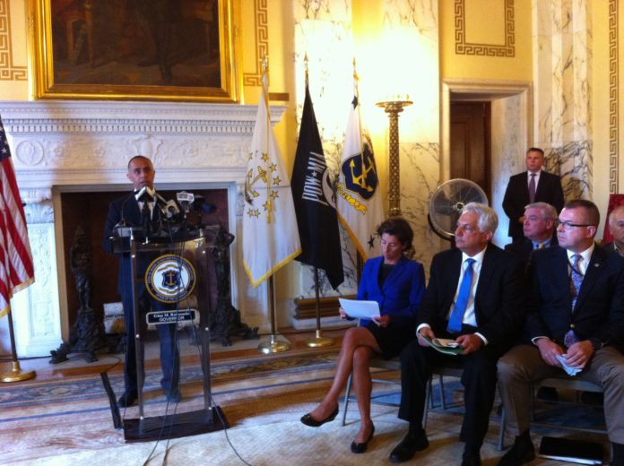PROVIDENCE MAYOR Jorge O. Elorza speaks at a press conference on Wednesday at the Statehouse about the reconstruction of the Route 6 and 10 interchange. Gov. Gina M. Raimondo is seen on the right, next to R.I. Department of Transportation Director Peter Alviti Jr. / PBN PHOTO/MARY MACDONALD