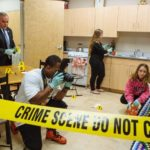 ALL IN THE DETAILS: New England Institute of Technology students, from left, Ray Angell, Shaun Mactavious, Courtney Beauchamp and Mikayla Guarino, learn how to process a crime scene as part of the school's criminal justice degree program. / PBN PHOTO/RUPERT WHITELEY