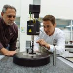 PINPOINT MEASUREMENT: Hexagon Manufacturing Intelligence helps other companies manufacture to more exacting standards, thanks to efforts by engineers like Paul Racine, left, and Scott Carlson. / PBN PHOTO/RUPERT WHITELEY
