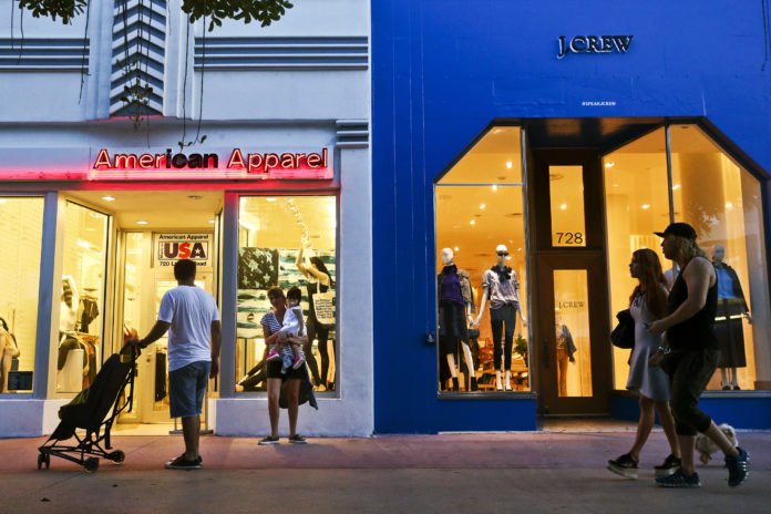 PEDESTRIANS pass in front of American Apparel LLC and J.Crew Group Inc. stores at the Lincoln Road Mall in Miami Beach, Fla. / BLOOMBERG NEWS/SCOTT MCINTYRE