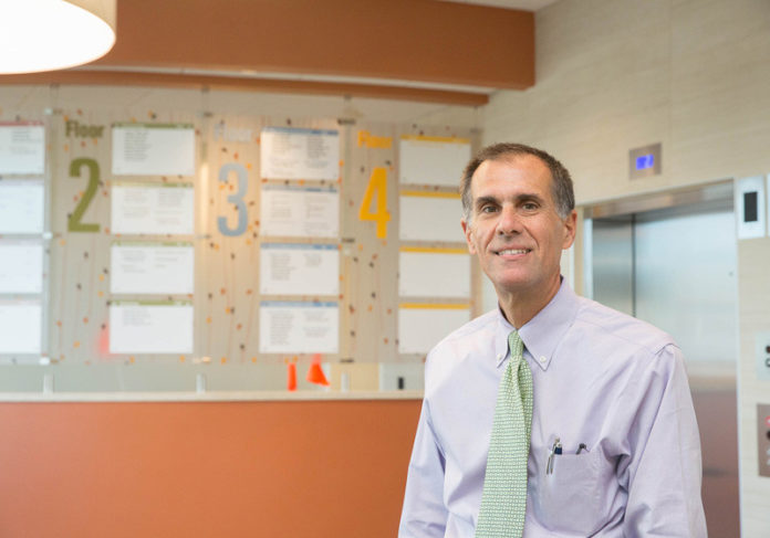 MODEL OF EFFICIENCY: Dr. Peter  Hollmann is chief medical officer of University Medicine Foundation, which opened its new facility in June and provides the opportunity for general practitioners and specialists to collaborate under one roof. / PBN PHOTO/TRACY JENKINS