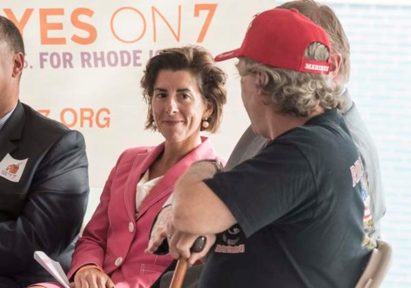 SUPPORTING VETS: Gov. Gina M. Raimondo shares a smile with Sam Lubbers, right, a former Marine from Michigan and an advocate for homeless veterans. They spoke at a rally held at the Gately Building in Pawtucket to support a $50 million bond to promote housing creation. / PBN PHOTO/MICHAEL SALERNO